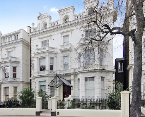 Kensington & Chelsea property market report Q4- exterior of stucco house in Holland Park