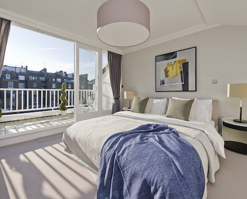 Kensington & Chelsea Property Market Report - master bedroom with view out to other houses
