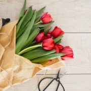 Top tips to sell your house this spring - bouquet of red tulips on a table